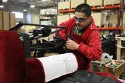 Pacific Furniture Industries' Oscar Cruz works at the company's manufacturing plant in Tualatin.