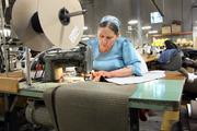 Pacific Furniture Industries' Wacilisa Dos Rios working in the company's manufacturing plant in Tualatin.