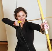 Liz Valentine, CEO, Swift Collective. Valentine regularly takes aim on her company's in-office archery range.