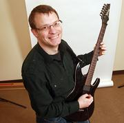 """Ken Westin, founder of GadgetTrak.Westin clears his head by playing his guitars, often with the amp cranked, a la the fictional band Spinal Tap, """"to 11."""""""