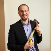 """Adam Zimmerman, executive vice president, Craft3.Zimmerman rescued this hammer, which denotes his company's mission of helping clients """"put stuff together,"""" from his late grandfather's tool bench."""