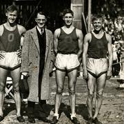 The 1934 University of Oregon mile relay team flanking University President C. V. Boyer, after winning the Northwest Conference championship at Hayward Field. From left to right: Sherwood Burr, Bill Bowerman, Boyer, George Scharpf and Howard Patterson.