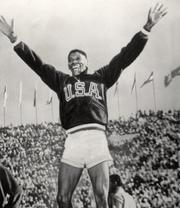 American Olympian and former University of Oregon runner Otis Davis celebrating a gold medal effort in the 400 at the 1960 Rome Olympics.