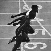 Don Quarrie and Steve Williams breaking the tape in the 220-yard dash at the first annual Steve Prefontaine Classic. The finish was the first sub-20 second mark at Hayward Field in the event.