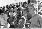 University of Oregon distance runner Steve Prefontaine (right) with Texas Southern sprinter Robert Taylor, watching action on the track at the 1972 Olympic Trials held at Hayward Field. Prefontaine finished 4th in the 5000 meters at the Munich Olympic Games and Taylor won gold in the 4 x 100 relay and silver in the 100 meters.