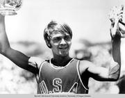 University of Oregon distance runner Steve Prefontaine, representing the United States, at a dual All-Star meet against the Soviet Union in Berkeley, California on July 3, 1971. Prefontaine is holding a trophy and his running shoes after setting a new U.S. record, winning the 5000 meter race.