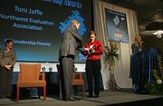 Toni Jaffe of Northwest Evaluation Association picks up her award in the medium company category.