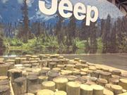 At Camp Jeep, consumers can ride in the newest Jeep models through a course that rambles over stumps and logs and up and down a 35-degree incline hill.
