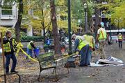Portland Parks & Recreation workers finish cleaning up downtown Portland's Chapman and Lownsdale squares Monday morning. Parks workers, including arborists, began the work of assessing the damage done by the nearly six-week Occupy Portland encampment.