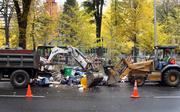The city brought in heavy equipment Monday morning to haul away the trash left behind in Chapman and Lownsdale squares following Sunday's efforts to clear the Occupy Portland demonstrators from the downtown parks.