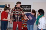 A Cornell student is fitted with a Pendleton-inspired look.