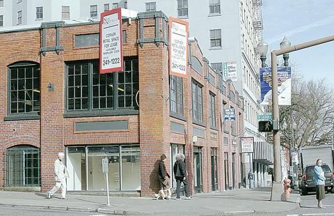The Goodman family will continue development efforts, including work on the Auto Rest garage in Portland's West End, after selling its parking management company.