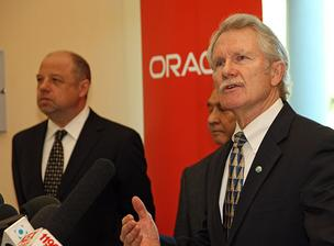 Gov. John Kitzhaber was joined by Oracle Vice President Lou Kowalski in announcing an incentive package that will keep Oracle in Hillsboro.
