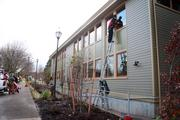 Workers put the finishing touches on the new addition's exterior.