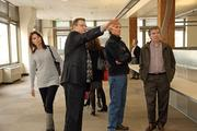 """Otak CEO R. """"Ryc"""" Nicholas Loope shows employees around what will be their new space in downtown Portland's Director Building."""