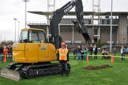Hillsboro Mayor Jerry Willey operated a diesel shovel that helped break ground on a new Hillsboro baseball stadium on Friday. Photo: Kevin Zuercher, City of Hillsboro