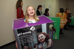 Girl Scout Alyssa Felder celebrates the opening of the first ever standalone retail outlet operated by the Oregon and Southwest Washington Council of Girl Scouts.