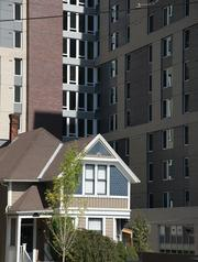 University Pointe, a 980-bed student residence, was built around a an existing home, which serves as a law office.