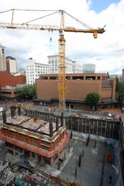 The crane over the Park Avenue West construction site spawned a law suit and was removed in 2011.
