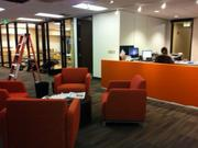 Collaboration in encouraged in the Business Journal's new space by low cubicle walls and casual gathering areas.