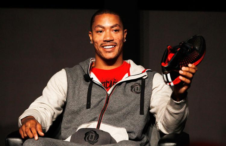 Chicago Bulls point guard Derrick Rose holds up the new D Rose 3 signature basketball shoe during a promotional event in September. Adidas America President Patrik Nilsson on Thursday said sales from the brand's basketball business increased 60 percent in the third quarter.