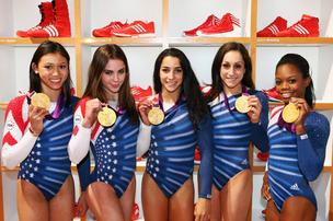 The U.S. women's gymnastics team show off their gold medal and their patriotic leotards during a visit this week to the Adidas Lounge at the London Olympics.
