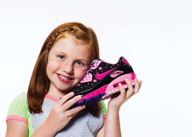 Autumn Boynton, 10, is a survivor of kidney cancer thanks to the transplant she received from her father.  She designed this women's Air Max90 DB featuring her favorite colors, pink and black, and is laden with stars and peace signs.