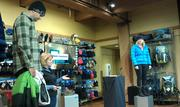 Adrienne Moser, Columbia Sportswear Co.'s vice president of apparel and accessories, showcases the brand's Fall '13 apparel line-up Wednesday. Shown here are jackets designed to keep consumers warm and comfortable while static in cold weather.