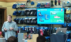 "Mark Nenow, Columbia Sportswear's vice president of global footwear, showcases the brand's Fall '13 collection during an event Wednesday at the company's flagship retail store in downtown Portland. The Columbia brand's Fall '13 collection will include both winter boots and trail shoes, with the idea being to appeal to more than just winter sports consumers and ""move from a winter brand to an outdoor brand,"" Nenow said."