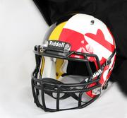"HGI painted these flag-draped ""Maryland Pride"" helmets designed by Under Armour Inc. for the University of Maryland. It's arguably the most controversial design among the modern helmet stylings. When Notre Dame played the Terrapins last year wearing gold helmets with giant green shamrocks on the side, the Baltimore Sun dubbed it the ""Ugly Helmet Bowl."""