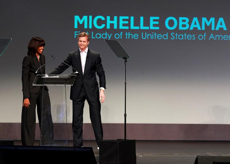 Nike Inc. CEO Mark Parker introduces First Lady Michelle Obama during a media event Thursday in Chicago. Nike announced it will invest $50 million over five years toward increasing physical activity in U.S. schools and communities.