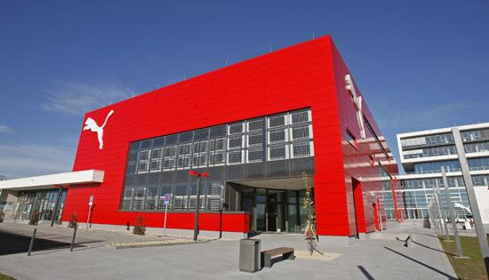 Puma's headquarters in Herzogenaurach, Germany. The athletic footwear and apparel brand cuts its profits and sales forecast and announced plans to close some stores after first-half sales slowed.