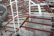 A construction worker works on the reinforcing beams that will underpin the Hillsboro Hops stadium.