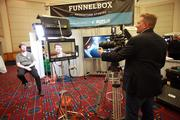 Funnelbox partnership strategist Greg Treat (seated) and CEO Rob Crocker demonstrate their capabilities. The Portland-based video production studio was one of several exhibitors at Thursday's BizGrowth Summit, which was held at the Oregon Convention Center.