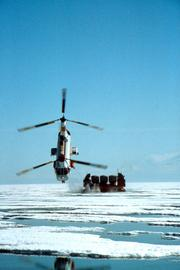 An example of the eye-catching photography found inside helicopter companies is this image of a Columbia Helicopters aircraft pulling a hover barge across the North Slope of Alaska.