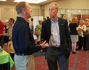 Jim Gianotti, an account manager with OKI Data Americas Inc., gets an audience with Portland State University President Wim Wiewel at Thursday's BizGrowth Summit at the Oregon Convention Center.