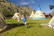 Kids play in tepees at Kah-Nee-Ta in Warm Springs, Ore.