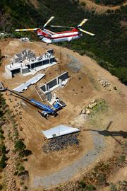 As interesting as an aircraft's history may be, its current work can be just as intriguing. In this image, a Columbia helicopter delivered wings of a Boeing 747 jet to Malibu, Calif., last year where they were turned into the roof of a house.