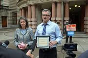 Mayor Sam Adams and Commissioner Amanda Fritz accepted an award for their effort to deposit more taxpayer money at local banks and credit unions.