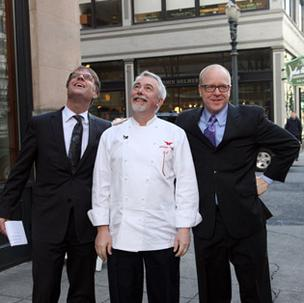 Heathman General Manager Chris Erickson (Left), chef Philippe Boulot and Garrett Peck, GM of the Heathman Restaurant and Bar watch as the French Flag is raised in Boulet's honor.