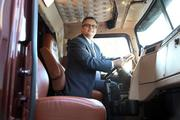 Portland Mayor Sam Adams sits in the driver's seat of one of Daimler Trucks North America's Western Star trucks Thursday at the company's Swan Island campus.