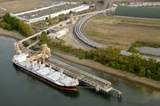Canpotex plans to constructa temporary conveyor system to transport material 800 feet from a barge in the Willamette River to a stockpile location where it will be moved to a proposed building site.