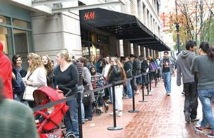 Crowds lined up for the Nov. 11 opening of Swedish clothier H&M at downtown Portland's Pioneer Place.