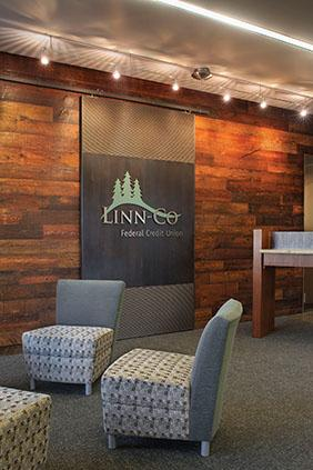 The customer waiting area at Linn-Co Credit Union, along with the teller stations demonstrate ways that the Bainbridge design firm maximixed its use of regional materials. The net effect is that the branch's lobby reflects the natural beauty found throughout Linn County and Oregon.