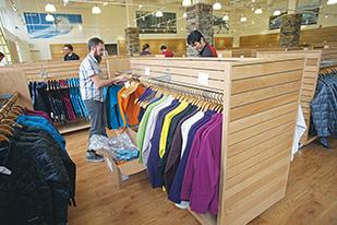 MontBell employees prepare the outdoor apparel retailer's new store for its opening, which is scheduled for Friday, Oct. 18.