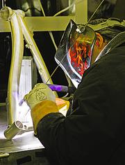 "Master welder Tchavdar ""Chevy"" Marinov works on a bike frame. Marinov is well-known in the industry for his expertise."