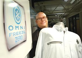 Woody Blackford, Columbia Sportswear's vice president of product innovation, holds a shirt from the Performance Fishing Gear collection made with Omni-Freeze Zero cooling technology.