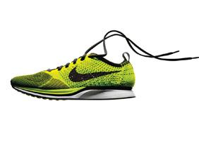 Nike Inc. CEO Mark Parker believes the manufacturing technology behind the company's Flyknit Racer shoes will help improve the company's profit margins as it spreads to other products.