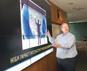 Gerry Perkel said Planar's digital sign business helped the company exceed its quarterly expectations.