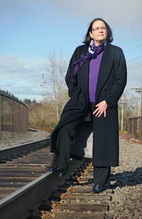 Lake Oswego City Councilwoman Mary Olson  opposes the streetcar-extension.